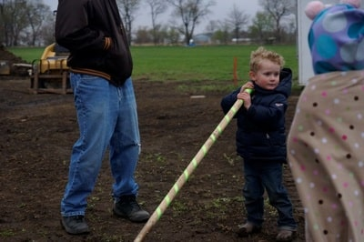 kid breaking ground
