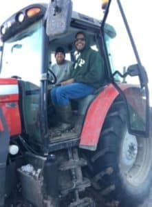 two men in a tractor