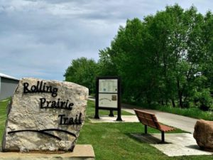 Rolling Prairie Bike Trail Sign at Trailhead with bench and kiosk with information