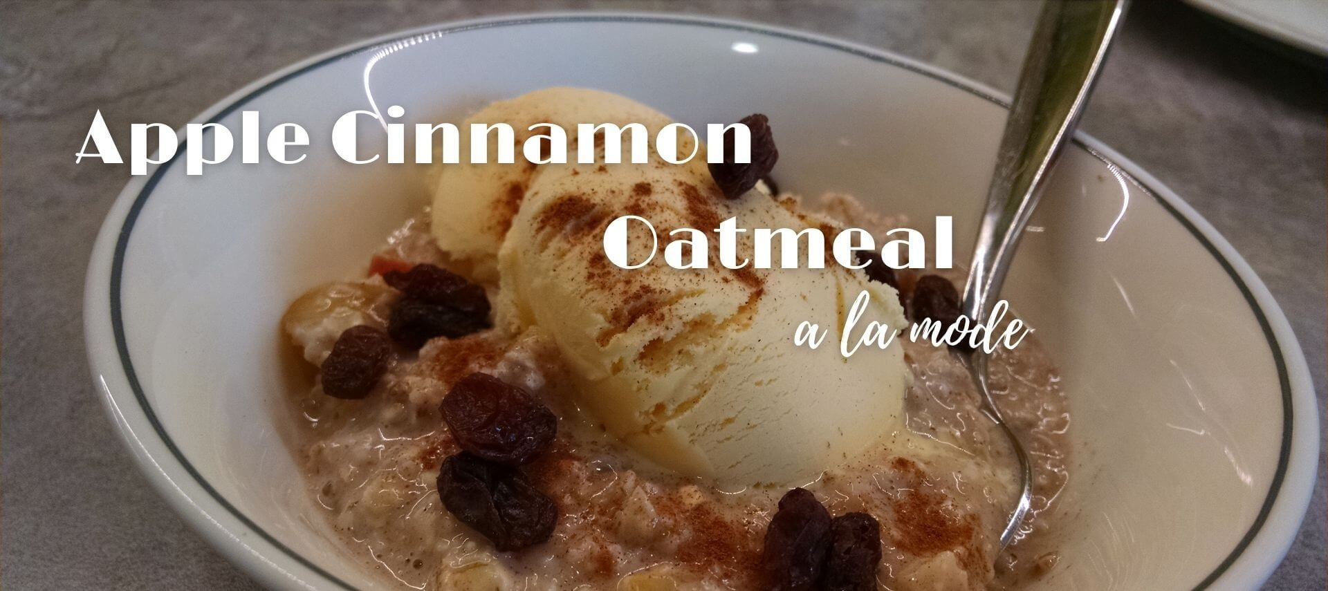 bowl of oatmeal with ice cream on top and spoon