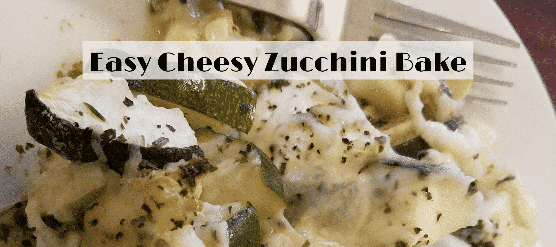 zucchini with cheese on plate with fork