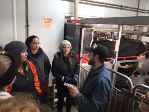 Group of People Touring Robot Room at Dairy Farm