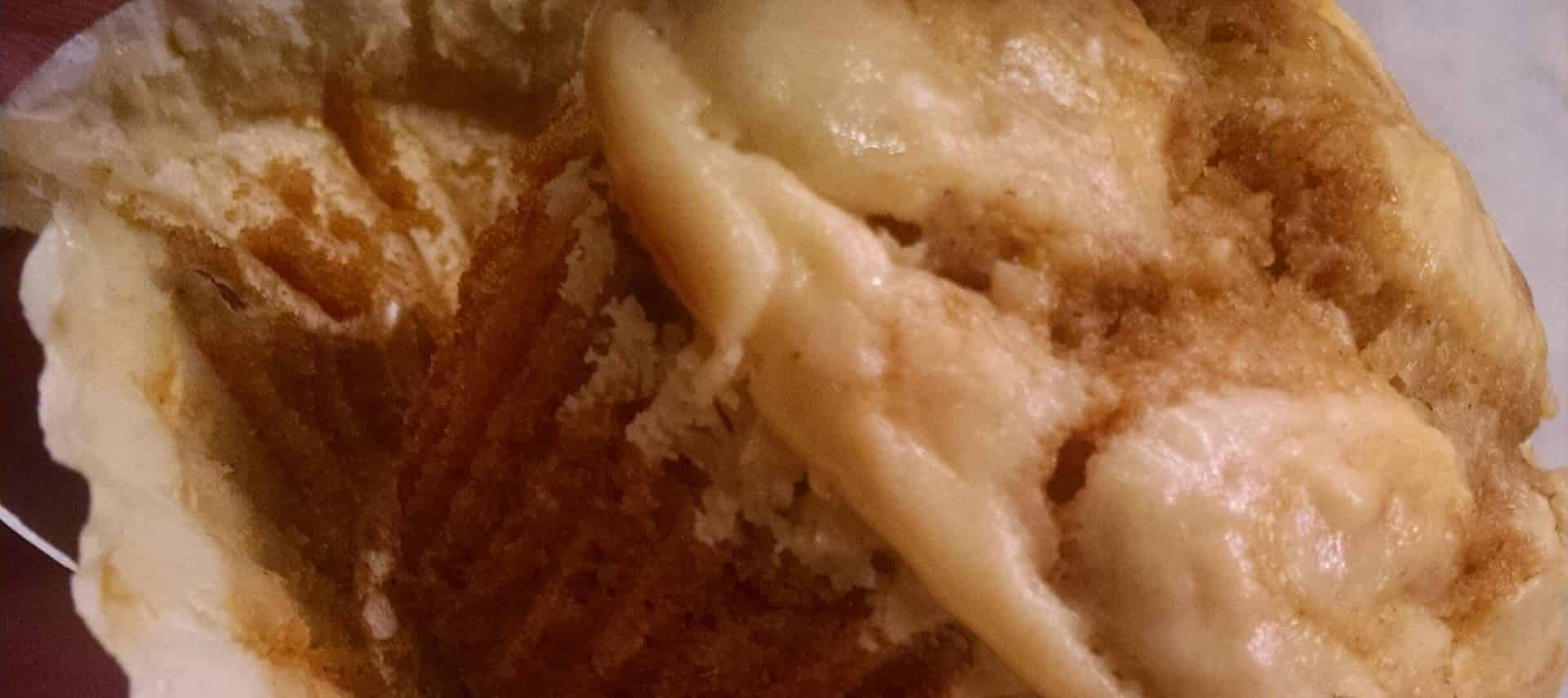 Close up view of pumpkin cream cheese muffin