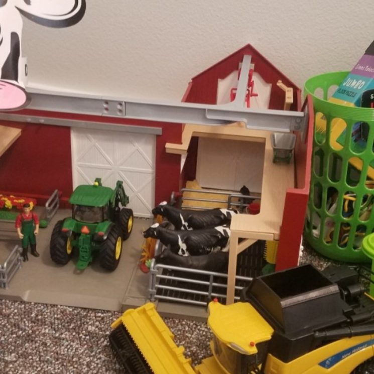 toy barn, tractors with coloring book, puzzle box, and paper cow hat